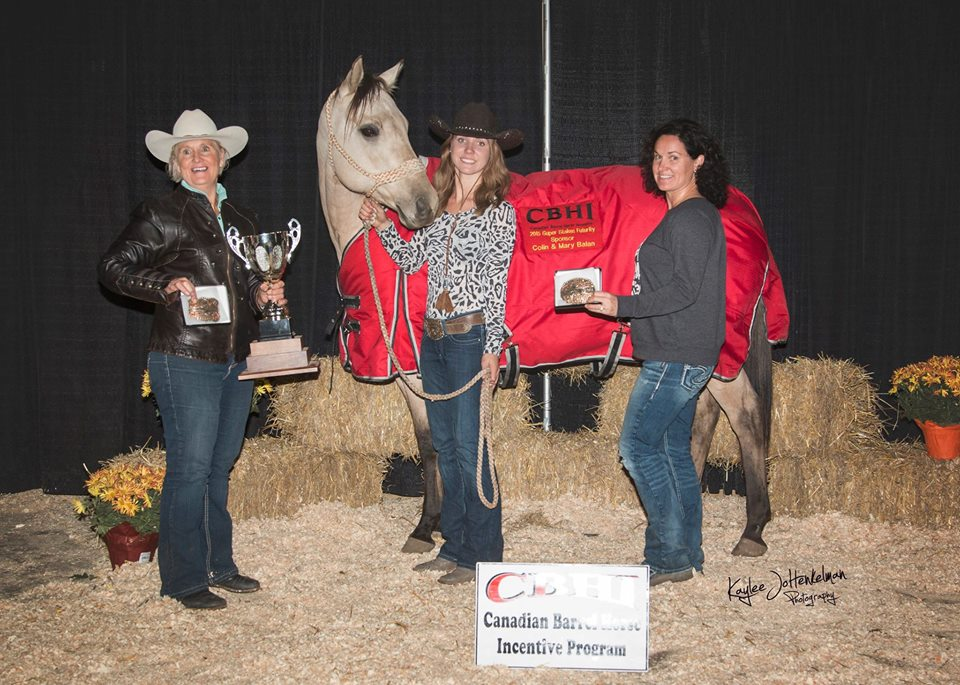Gwen Broderson at left holding the stallion cup.  Gwen will also take home $7800 for being the stallion owner.  Jordie Likes with Heavensent King Girl and  Jordie's Mom Tanya Likes at right. Photo by Kaylee Jo Henkelman visit Kaylee-Jo's website for your own futurity action shots.
